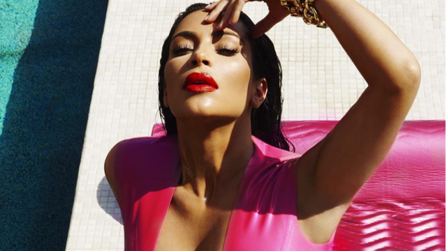 Kim Kardashian shared new pics where she's fully clothed (in skin-tight latex).
