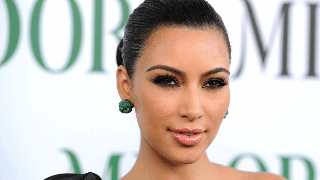 Kim Kardashian sues blog over reports that her Paris robbery was staged.