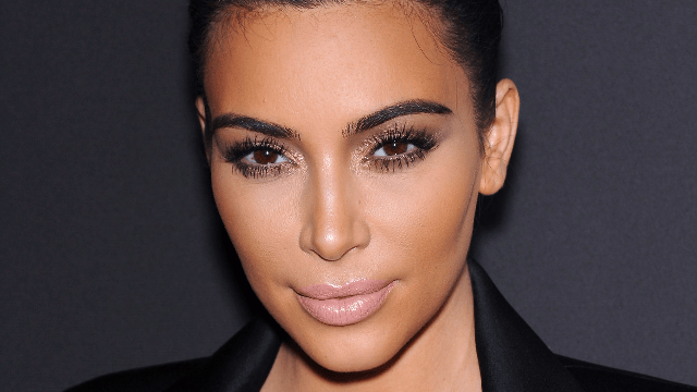 Don't pretend you don't want to hear why Kim Kardashian decided to stop hiding her nipples.