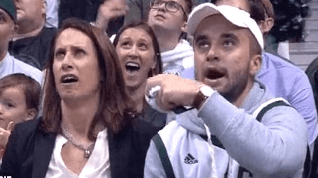 Mom and son survive awkward moment on Kiss Cam.