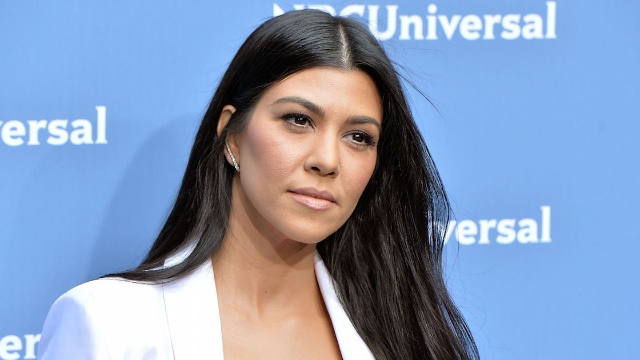 Kourtney Kardashian gets mom shamed for showing too much ass at the beach.