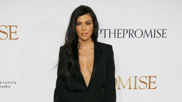 Kourtney Kardashian responds to fan who says she looks pregnant, sparking a debate on body image.