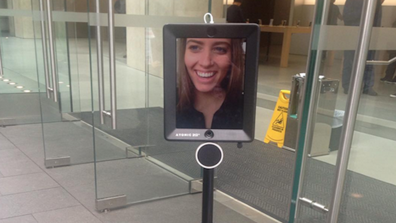 Robot waits in line to buy iPhone for a very, very smart woman.