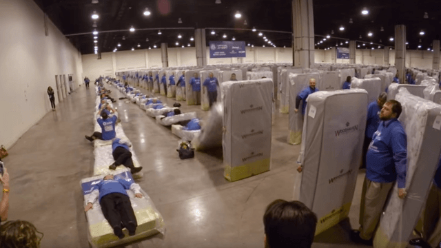 This video of the world's largest 'human mattress domino' chain will make you weirdly sad.