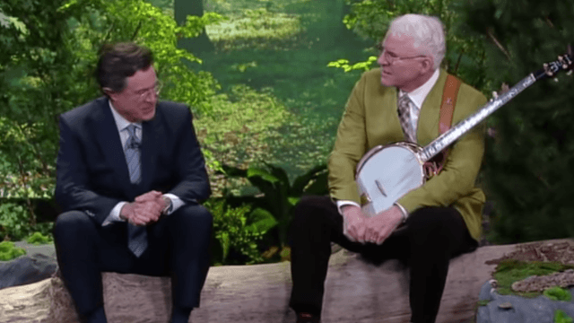 Watch Steve Martin and Stephen Colbert jam to a new banjo tune about friendship in a fake forest.