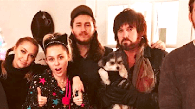 Liam Hemsworth could not look more out of place in this Cyrus family Christmas photo.