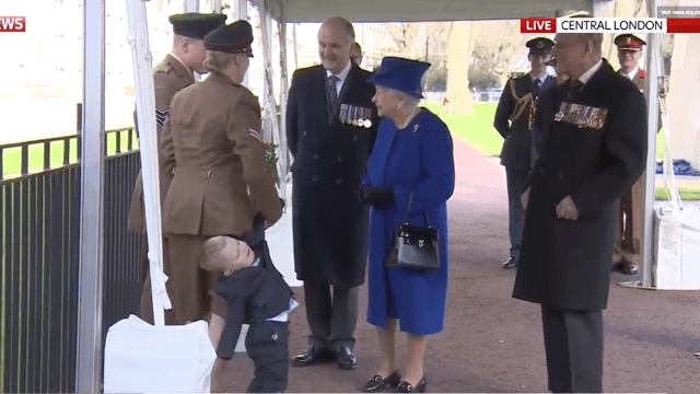 Grumpy kid doesn't give one s**t about meeting the Queen.
