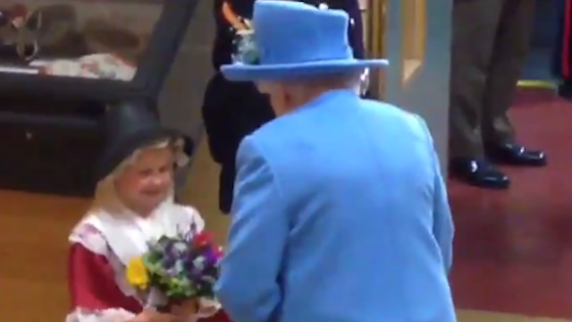 Little girl meets Queen, immediately gets smacked in face.