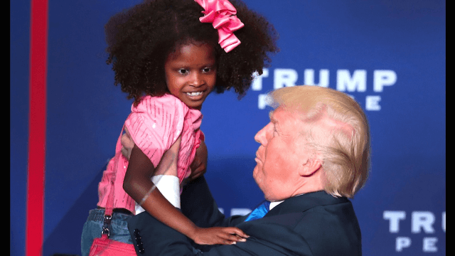 Donald Trump tries to kiss flinching little girl as internet looks on in horror.
