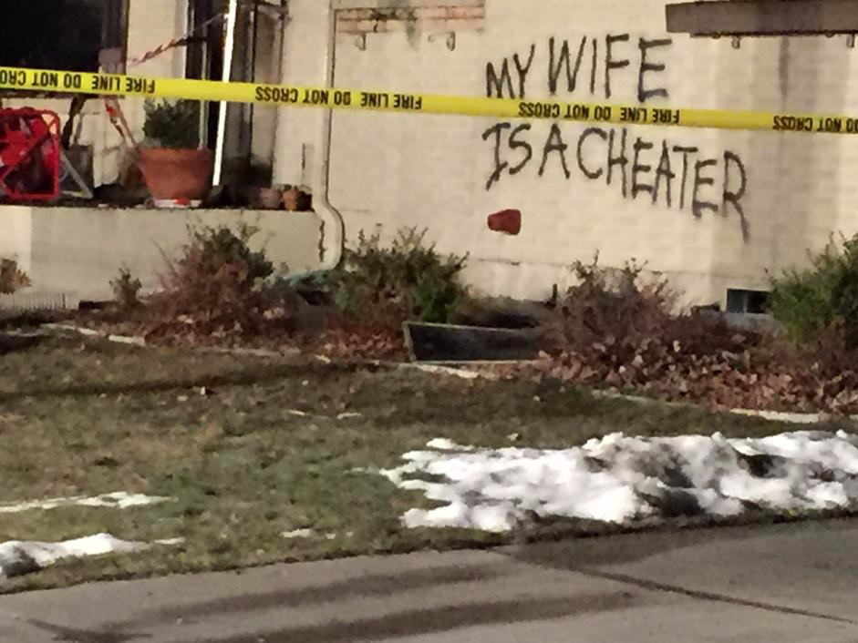 """Lovers' spat: """"My wife is a cheater"""" spray-painted on house that explodes, catches fire."""