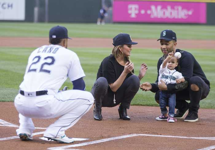 Chrissy Teigen and John Legend's daughter Luna adorably throws the first pitch at a baseball game.