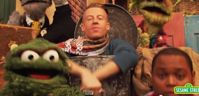 Macklemore stopped by 'Sesame Street' to rap about trash with Oscar the Grouch.