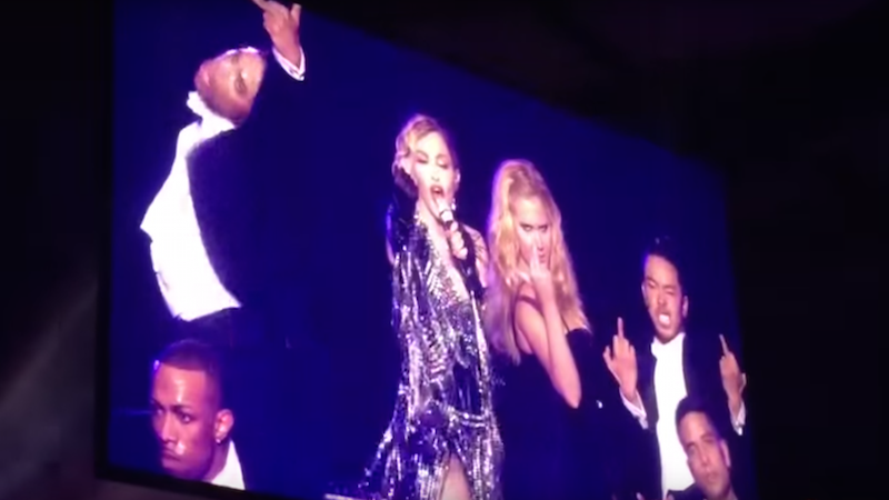 Madonna and Amy Schumer performed a NSFW dance and sock puppet bit at a concert last night