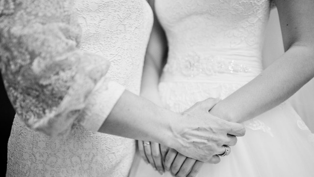 Maid of Honor asks if she was right to tell bride's mother to change out of white dress.
