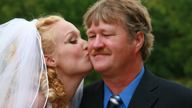 Man asks if he's wrong for not footing wedding bill after stepdaughter's abusive dad is invited.