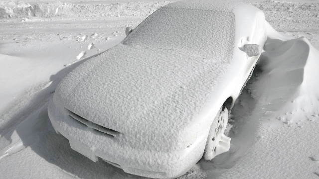 Man tricks cops with car made of snow, receives fake parking ticket.