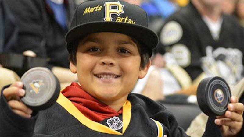 Monster of a man steals puck tossed to kid at NHL game, but the team makes up for it.