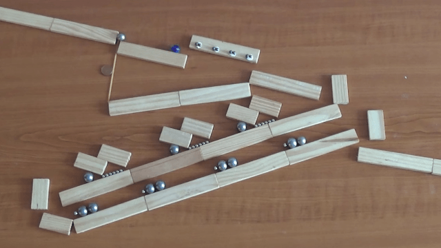 Get ready to be transfixed by this marble-and-magnet Rube Goldberg machine.