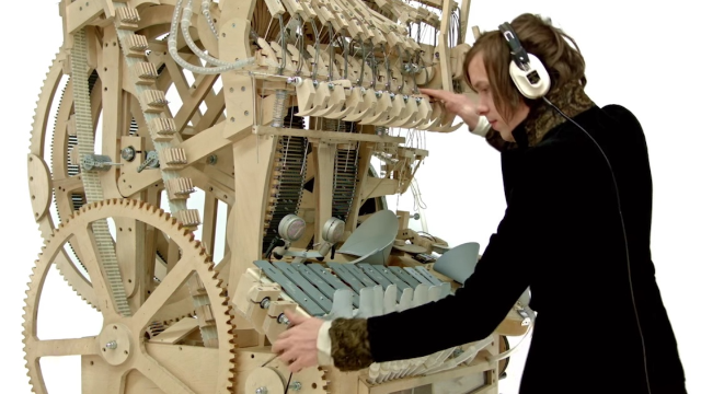 Everyone is mesmerized by this complicated marble machine that plays one (awesome) song.