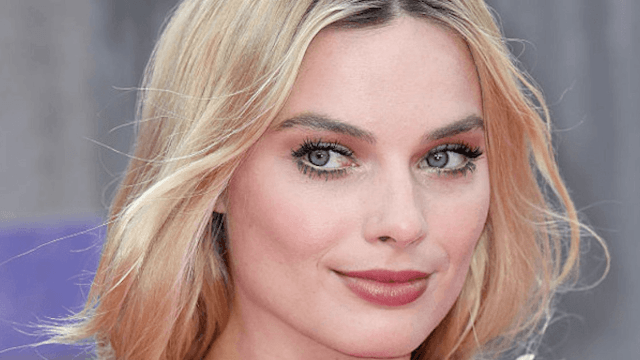 Margot Robbie's wedding ring and gown are as gorgeous as she is.
