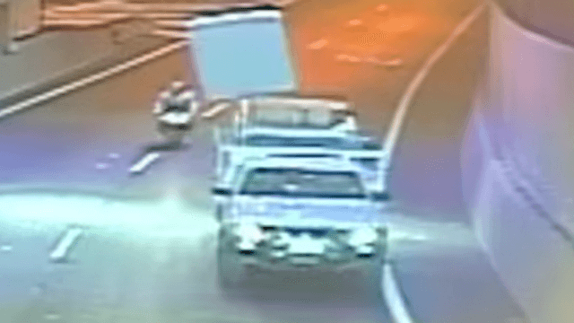 Mattress flies off a truck but instead of causing an accident, it prevents one.
