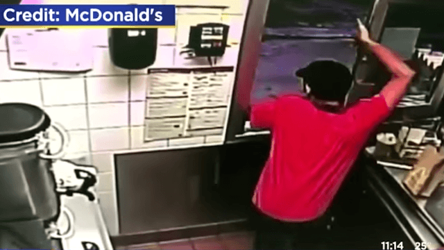 McDonald's worker heroically leaps through drive-thru window to save a customer's life.