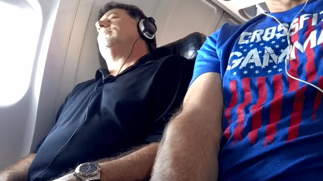 Guy in middle seat takes back armrest, captures seatmate's incredible stink eye on camera.