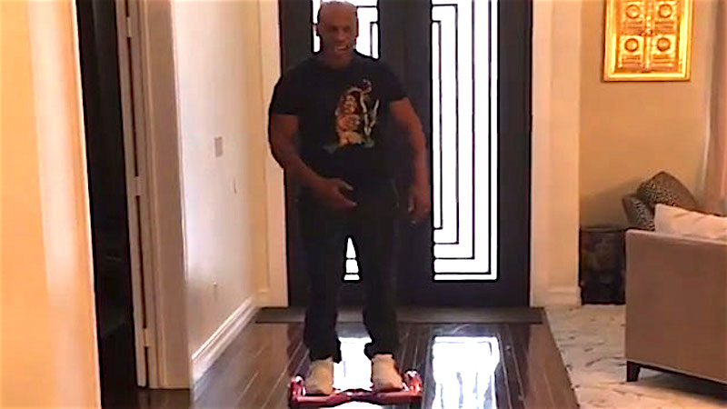 Mike Tyson lasts 11 seconds in a round with his daughter's hoverboard.