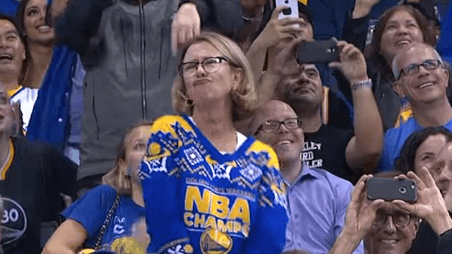 May we all feel as wild and free as this mom dancing at a basketball game.