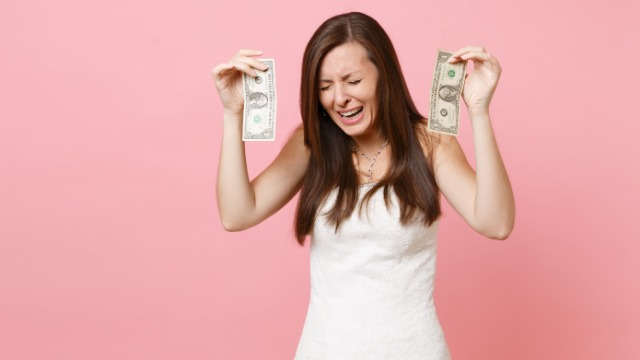 Mom asks if it's wrong to give two daughters different wedding funds based on their success.