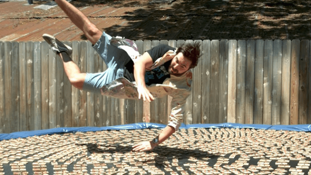 Watch this guy slow-motion jump onto a trampoline covered in mousetraps so you don't have to.