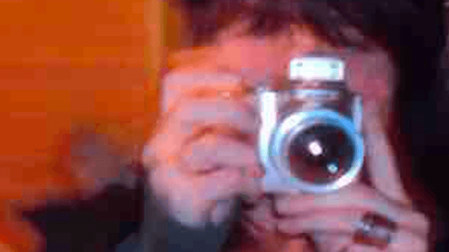 The Internet is fascinated by whatever the hell is lurking behind this woman in her selfie.