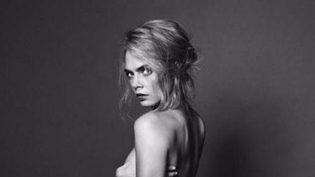 Cara Delevingne gets naked enough to show you lots of side boob.