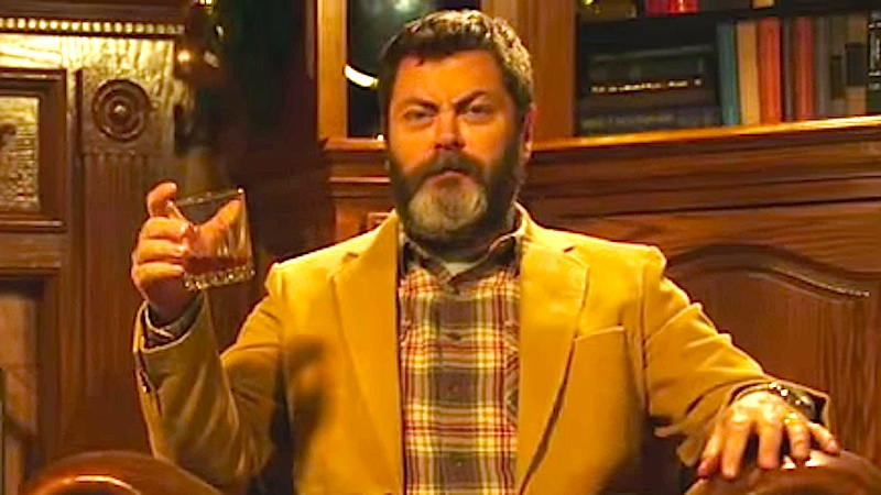 Your new holiday tradition is watching Nick Offerman drink whiskey by a fire for 45 minutes.