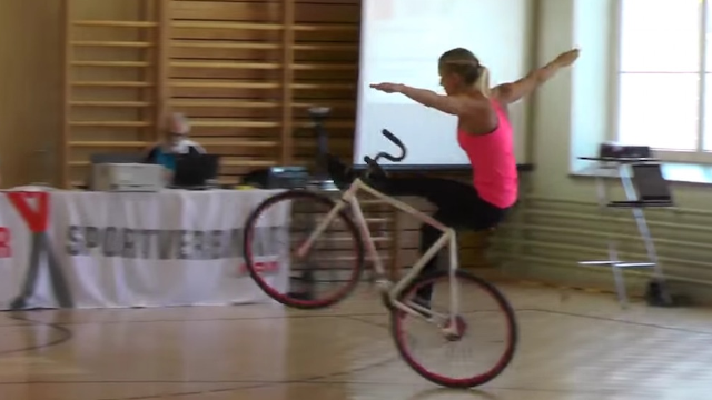 Artistic cyclist will make you wonder how her bike tricks are even humanly possible.