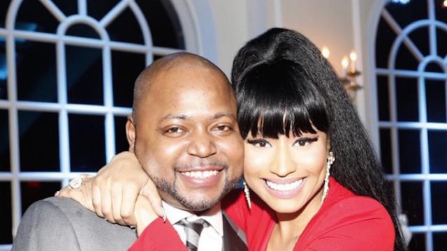Nicki Minaj sorta, kinda toned it down to attend her brother's wedding in a low-cut red dress.