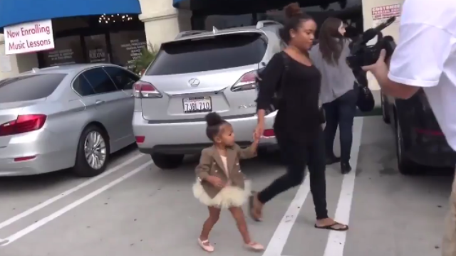 2-year-old North West rebels against family, tells paparazzi to stop taking her photo.