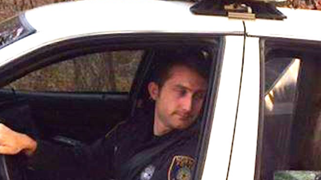 Cop stops traffic to put a miniature donkey in the backseat of his cruiser.