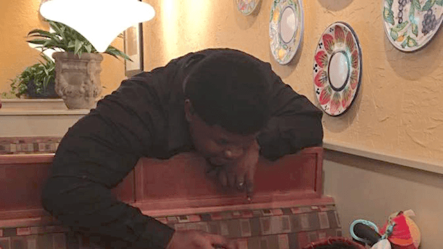 World's best Olive Garden waiter makes mom's day after her baby gets sick.