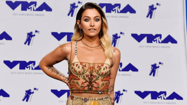 Paris Jackson goes topless to show off her new chest tattoo. It's very spiritual.