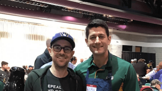 Paul Ryan probably should have read this dude's T-shirt before taking a photo with him.