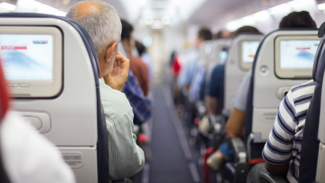 People are divided over video of passenger punching reclining woman's seat on flight.