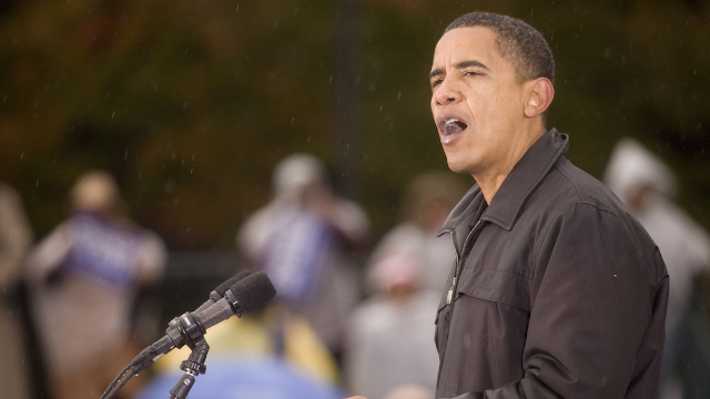 People are sharing pictures of Obama in the rain to drag Trump for being afraid of water.