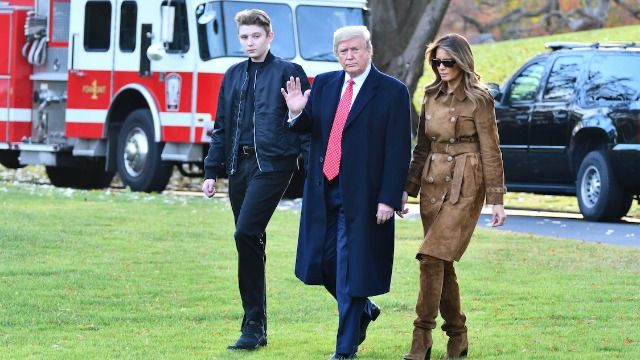 """16 reactions to a photo of 6'7"""" Barron Trump towering over Melania."""