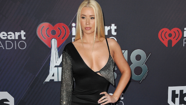 Iggy Azalea is competing with Peppa Pig to see who will sell more albums.