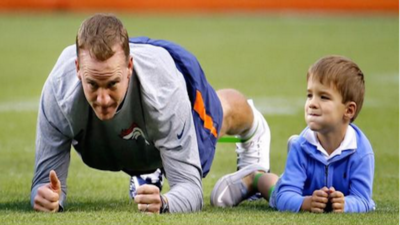 Peyton Manning's son does adorable pregame stretch with dad before Broncos game.