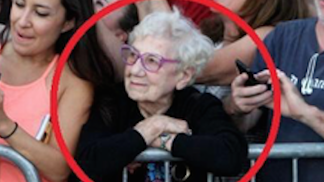Photo of an old woman in a crowd goes viral for reminding the Internet that the real world exists.