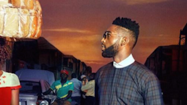Nigerian woman gets modeling contract after photobombing pop star Tinie Tempah.