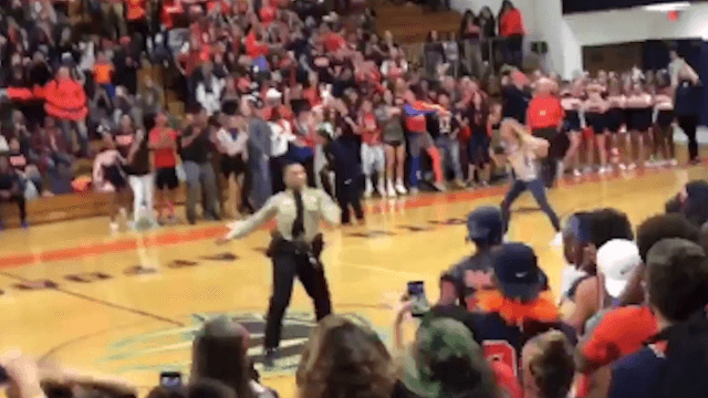 Watch a police officer slay Beyoncé's 'Formation' at a school pep rally.