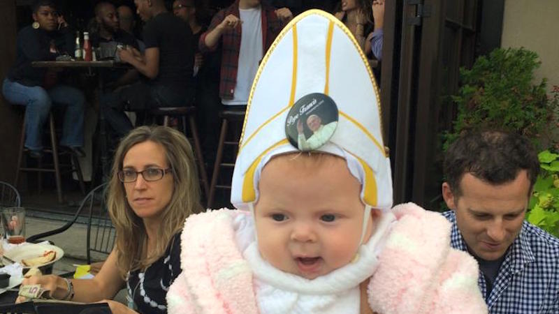 Watch Pope Francis laugh his holy head off after seeing a baby in a Pope outfit.